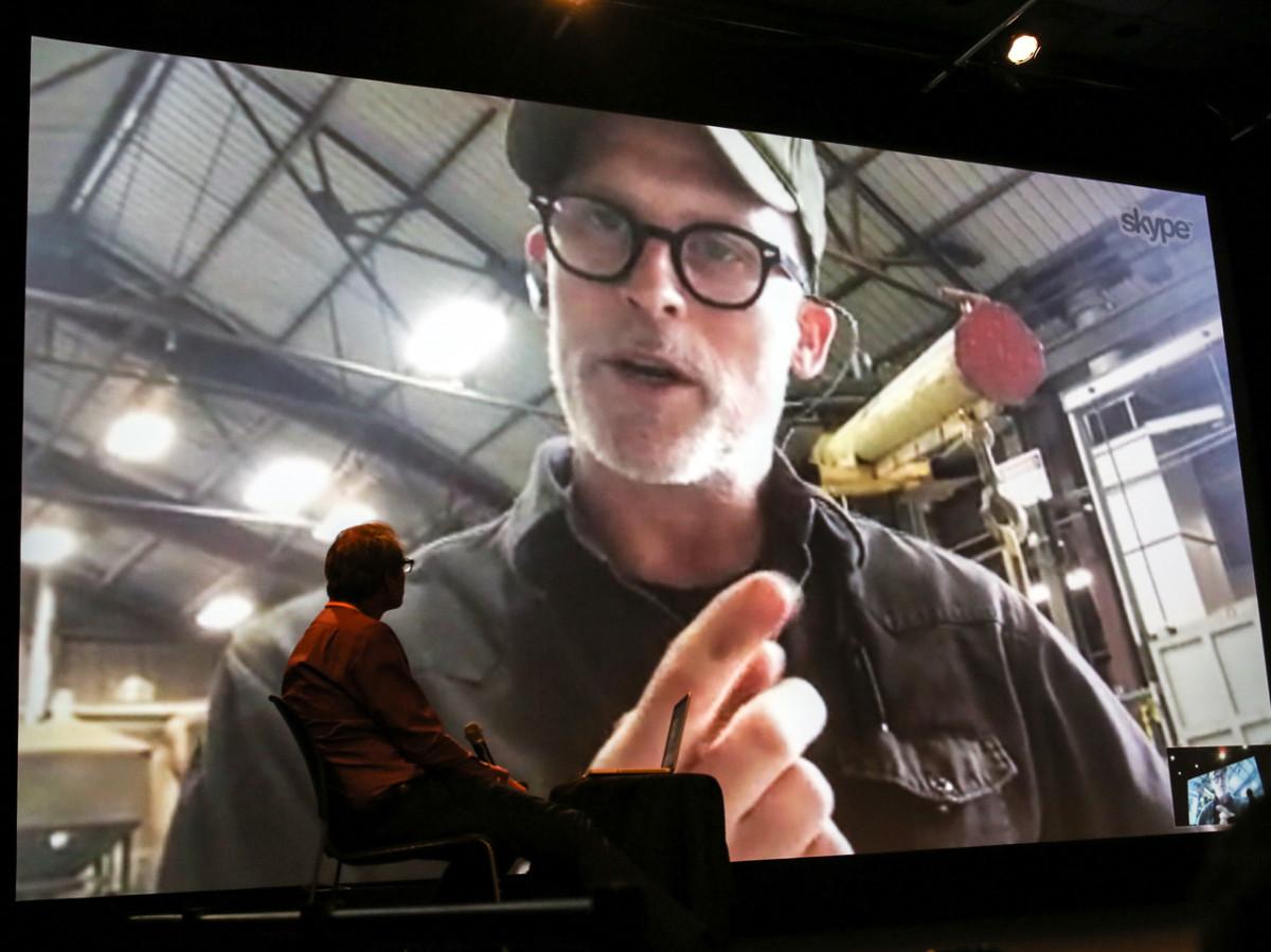 A photo of Christian Schiedemann conducting a Skype interviewwith artist Matthew Barney