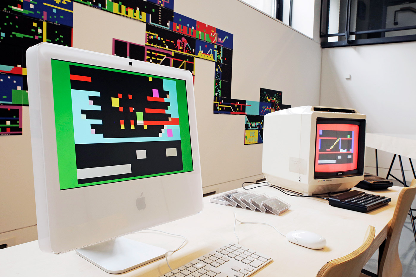 "Left: JODI, Jet Set Willy Variations .SNA (JSW011), 2002 ZX Spectrum software as 48K snapshots, ZX Spectrum emulator and duplicable hardware; shown: iMac 21,5"" (late 2012) with OS X Yosemite Version 10.10.5 Right: JODI, Jet Set Willy Variations .TAP (JSW011), 2002 ZX Spectrum computer software on audiocassette and duplicable hardware; shown: ZX Spectrum computer, audiocassette player, Sony KV-1400 14"" TV with colour, sound and RF Behind: JODI, Jet Set Willy Variations .MAP (JSW011), 2002 - present Duplicable print (free download at jetsetwillyvariations.com), dimensions variable Installation detail of JODI: Variable Art for the ZX Spectrum (2016), Dundee Contemporary Arts (Visual Research Centre) Photo: Kathryn Rattra, courtesy NEoN Digital Arts"