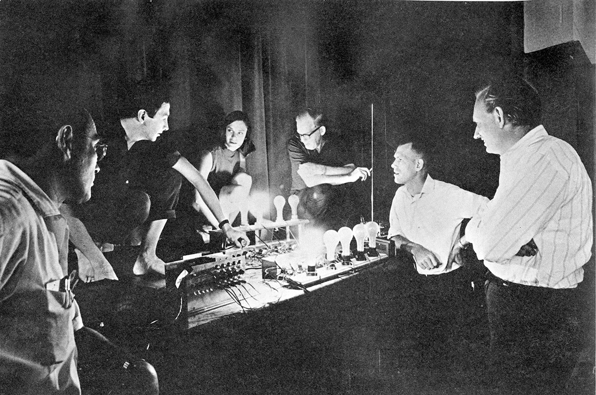 Artists and Engineers demonstrating the TEEM light and sound control system at a technical rehearsal for the performances at 9 Evenings: Theatre& Engineering. From Left; Herb Schneider, Robert Rauschenberg, Lucinda Childs Roby Robinson, Per Biorn, Billy Klüver. Photo Franny Breer.