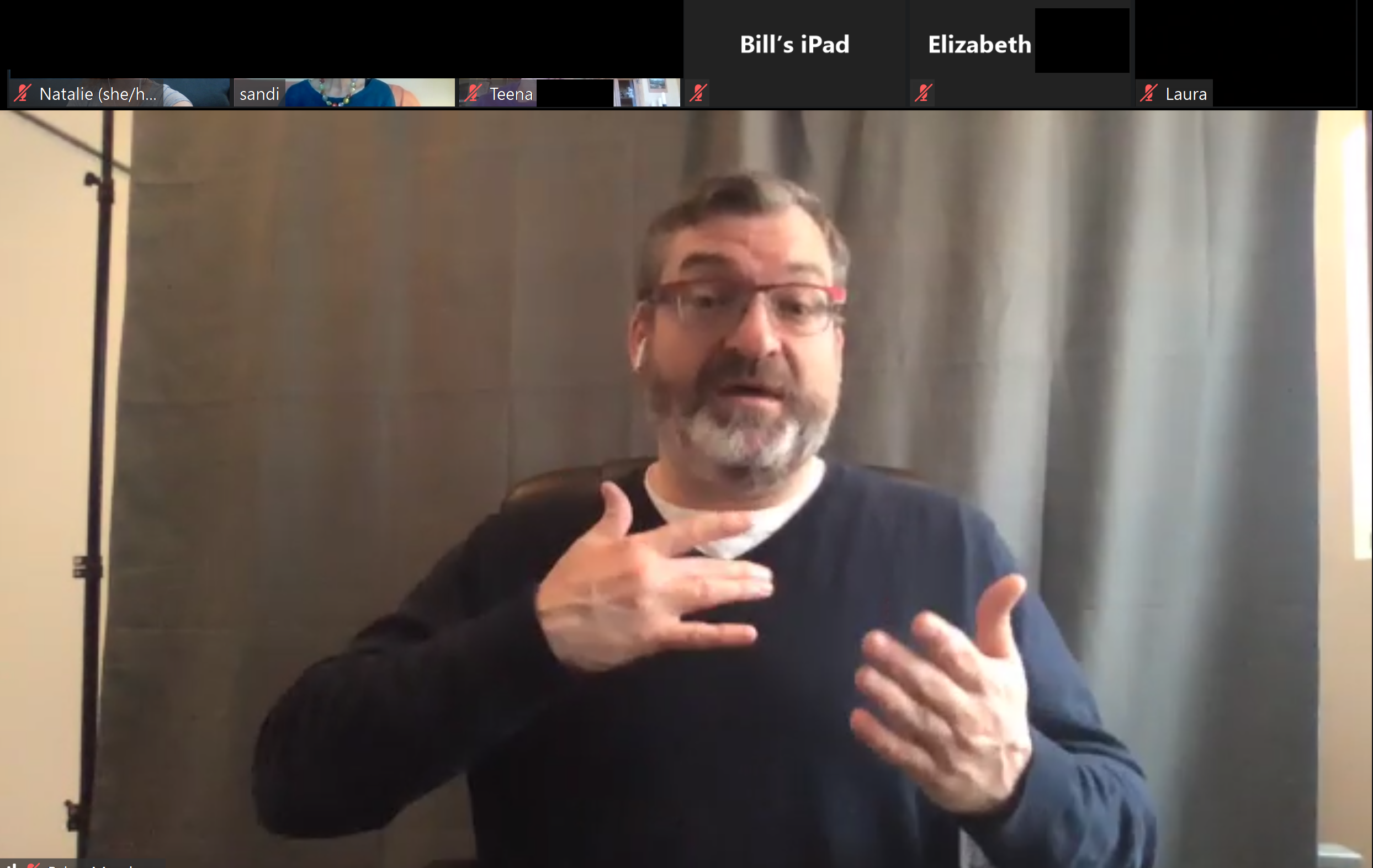 A screenshot of Brian from Hands UP Productions signing for a digital Mindfulness session via Zoom