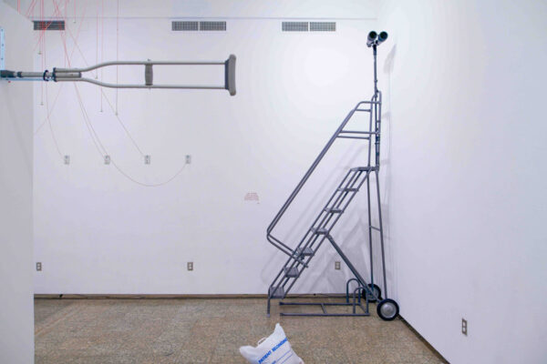 "A photograph of a performance piece by artist Panteha Abareshi titled ""And I Gaze"""