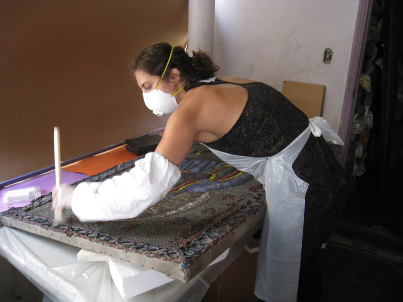 Sarah Scaturro surface cleaning a sequined flag