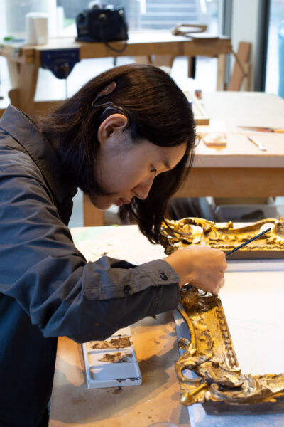 A photo of conservator Sally Gunhee Kim